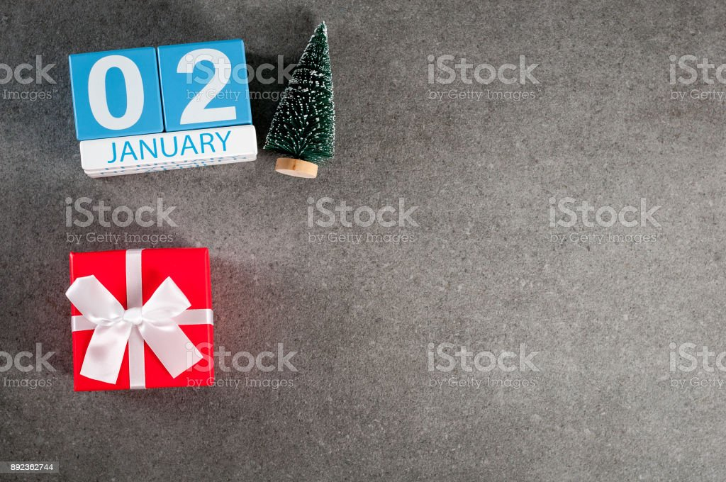 January 2nd. Image 2 day of January month, calendar with x-mas gift and christmas tree. New year background with empty space for text, mockup stock photo