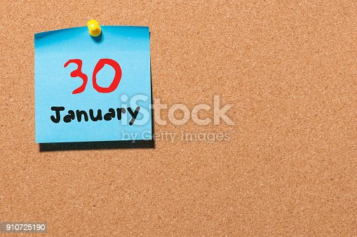 619522908istockphoto January 30th. Day 30 of month, Calendar on cork notice board. New year at work concept. Winter time. Empty space for text 910725190