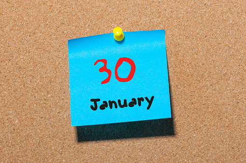 619522908 istock photo January 30th. Day 30 of month, Calendar on cork notice board. New year at work concept. Winter time. Empty space for text 910725454