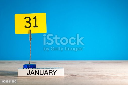 istock January 31st. Day 31 of january month, calendar on blue background. Winter time. Empty space for text, mock up 908881360