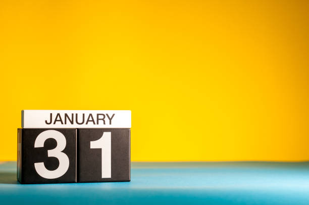 January 31st. Day 31 of january month, calendar on yellow background. Winter time. Empty space for text stock photo