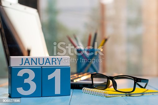 945046208 istock photo January 31st. Day 31 of month, calendar on workplace background. Winter at work concept. Empty space for text 906527896