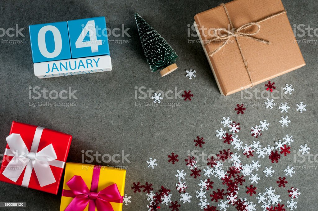 January 4th. Image 4 day of january month, calendar at christmas and happy new year background with gifts stock photo