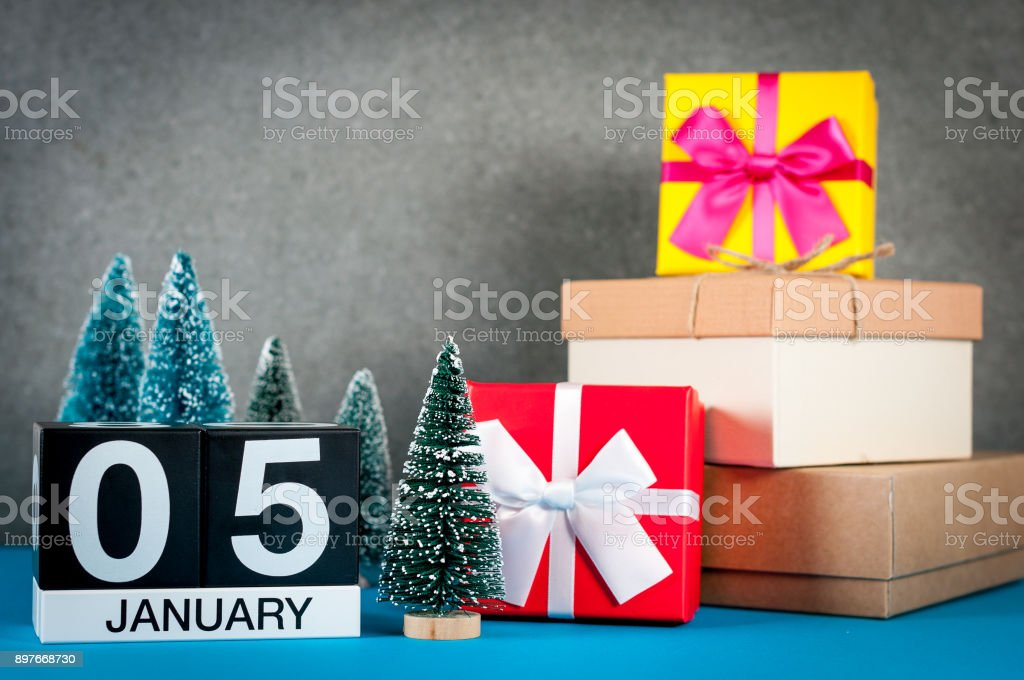 January 5th. Image 5 day of january month, calendar at christmas and new year background with gifts and little Christmas tree stock photo