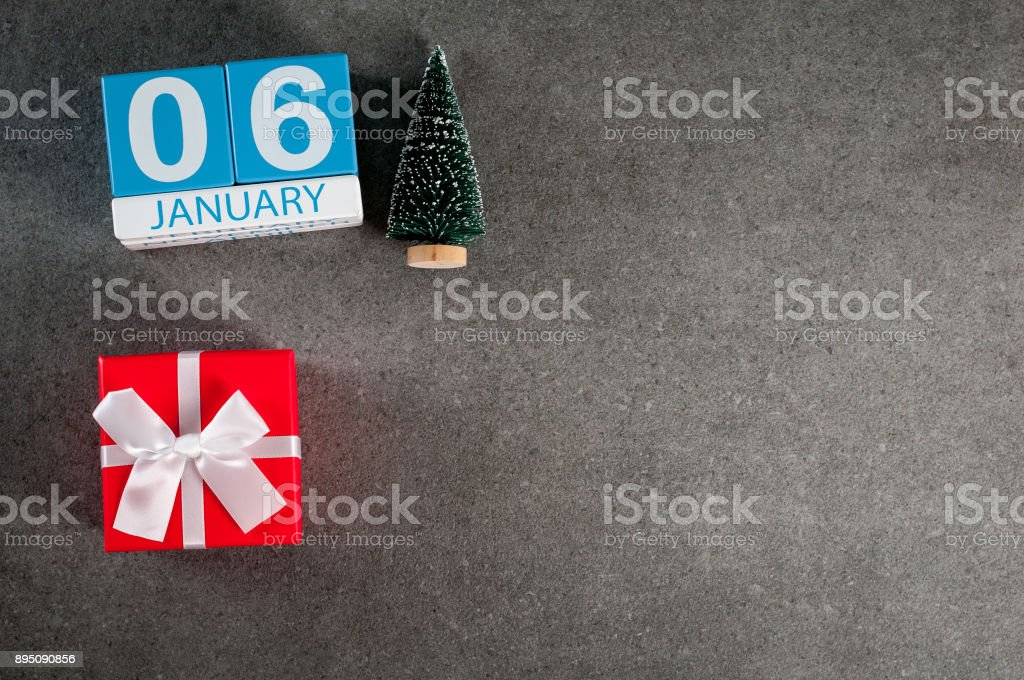 January 6th. Image 6 day of January month, calendar with x-mas gift and christmas tree. New year background with empty space for text, mockup stock photo