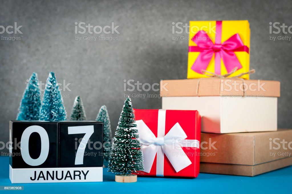 January 7th. Image 7 day of january month, calendar at christmas and new year background with gifts and little Christmas tree stock photo