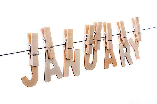 January in wooden letters on clothesline stock photo
