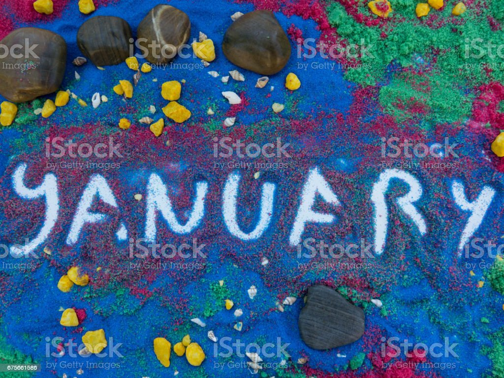 january written  in colors sand royalty-free stock photo
