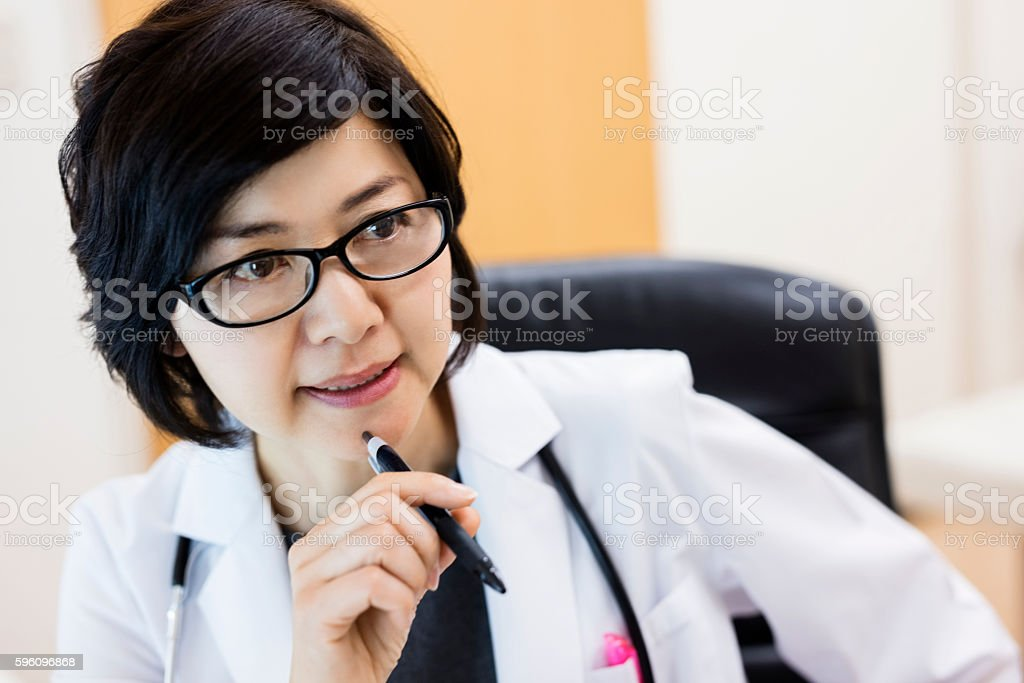jaoanese female doctor holding pen in hospital royalty-free stock photo