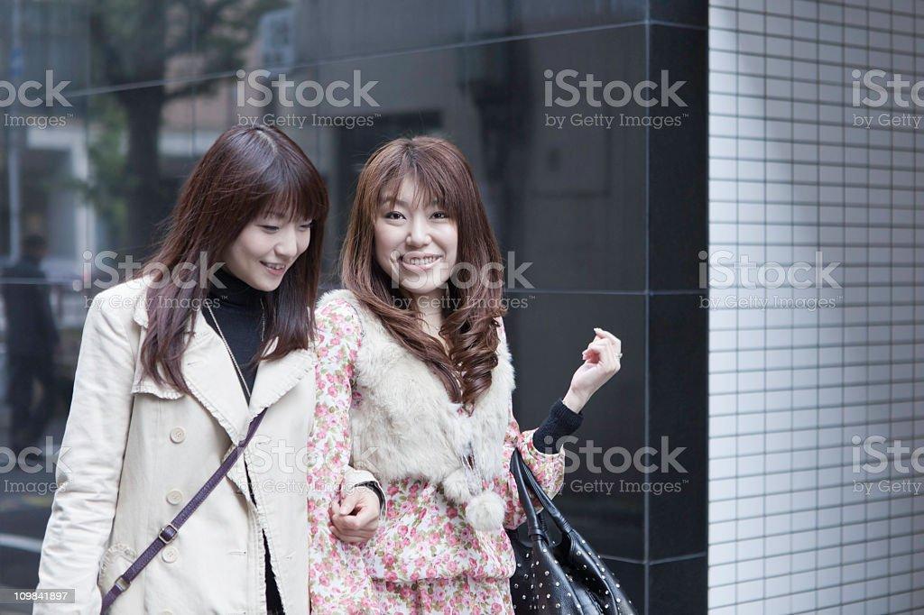 Japaense Friends Walking in City royalty-free stock photo