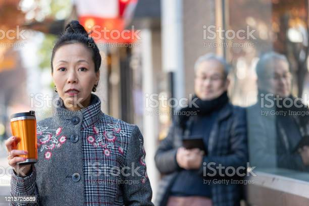 Japaense woman walking on street picture id1213725889?b=1&k=6&m=1213725889&s=612x612&h=grqt82owp08mkmawxvta3aolr7w2ewdrof0np9zo7ts=