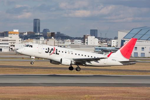 Osaka, Japan - November 29, 2013: Japan Airlines Embraer Emb-170-100LR taking off at Osaka International Airport in Osaka Prefecture, Japan. Japan Airlines is the flag carrier of Japan.