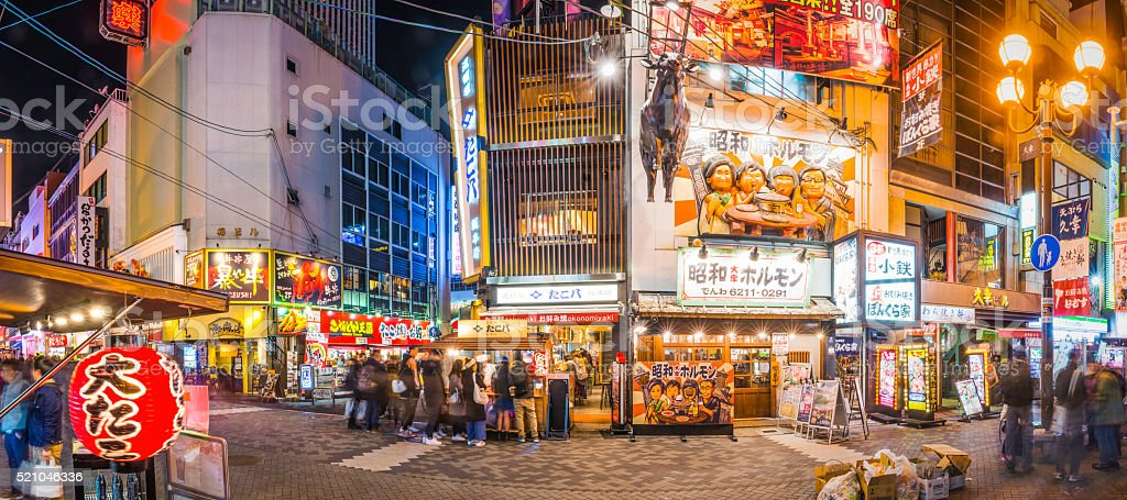 Japan Dotonbori neon nightlife restaurants bars crowded streets panorama Osaka stock photo