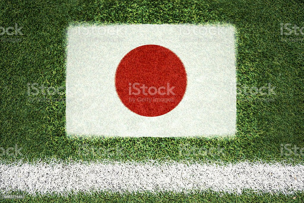 Japan flag printed on a soccer field royalty-free stock photo