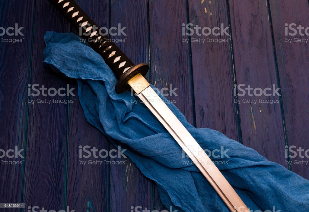 japan katana sword on the wood background with the blue shawl stock photo