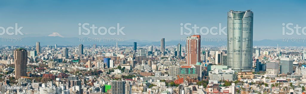 Japan Mt Fuji white snow volcano Tokyo skyscrapers Roppongi panorama stock photo