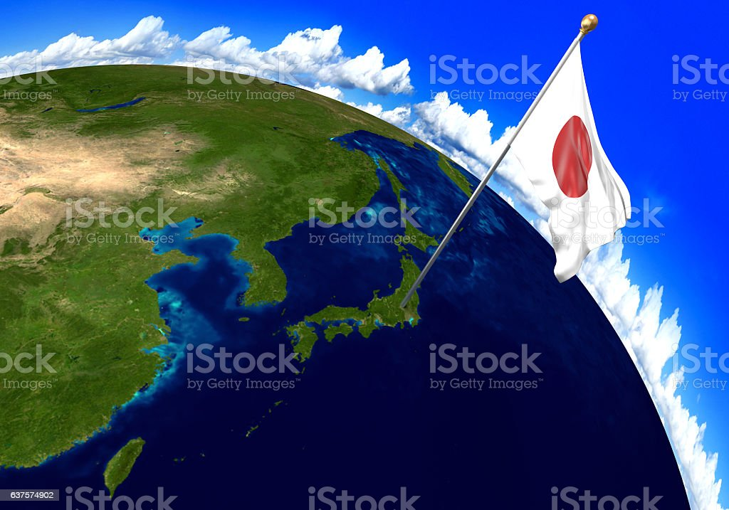 Japan national flag marking the country location on world map - foto de stock