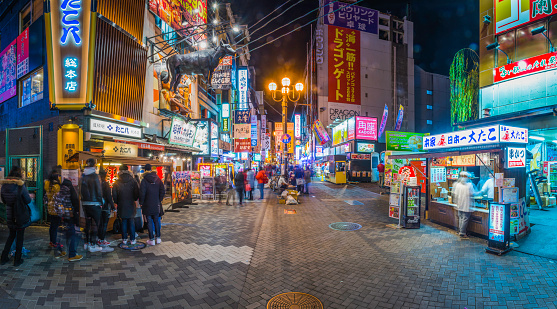 Japan nightlife crowds at colorful neon restaurants panorama Dotonbori Osaka