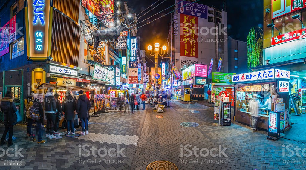 Japan nightlife crowds at colorful neon restaurants panorama Dotonbori Osaka stock photo