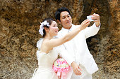Happy full of wedding photos taken along the beach in Japan Okinawa Prefecture