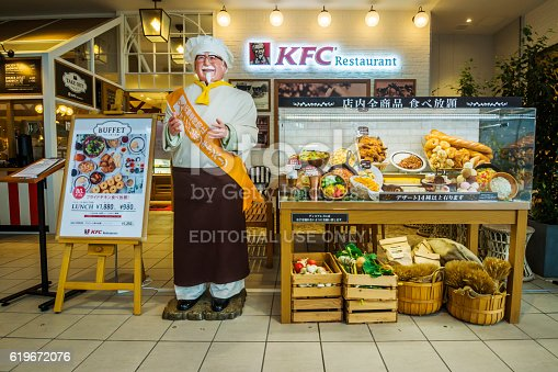 Osaka, Japan - October 25, 2016: A food display and signage outside a KFC restaurant at Lalaport Expocity.