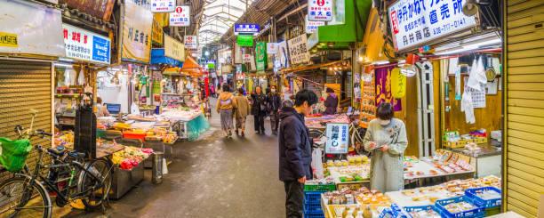 Japan shoppers in busy covered market Namba panorama Osaka stock photo