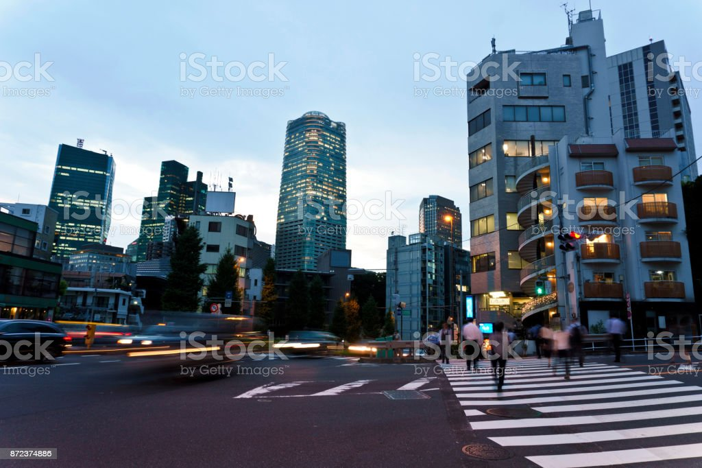 Japan, Tokyo, Night view of road crossing stock photo