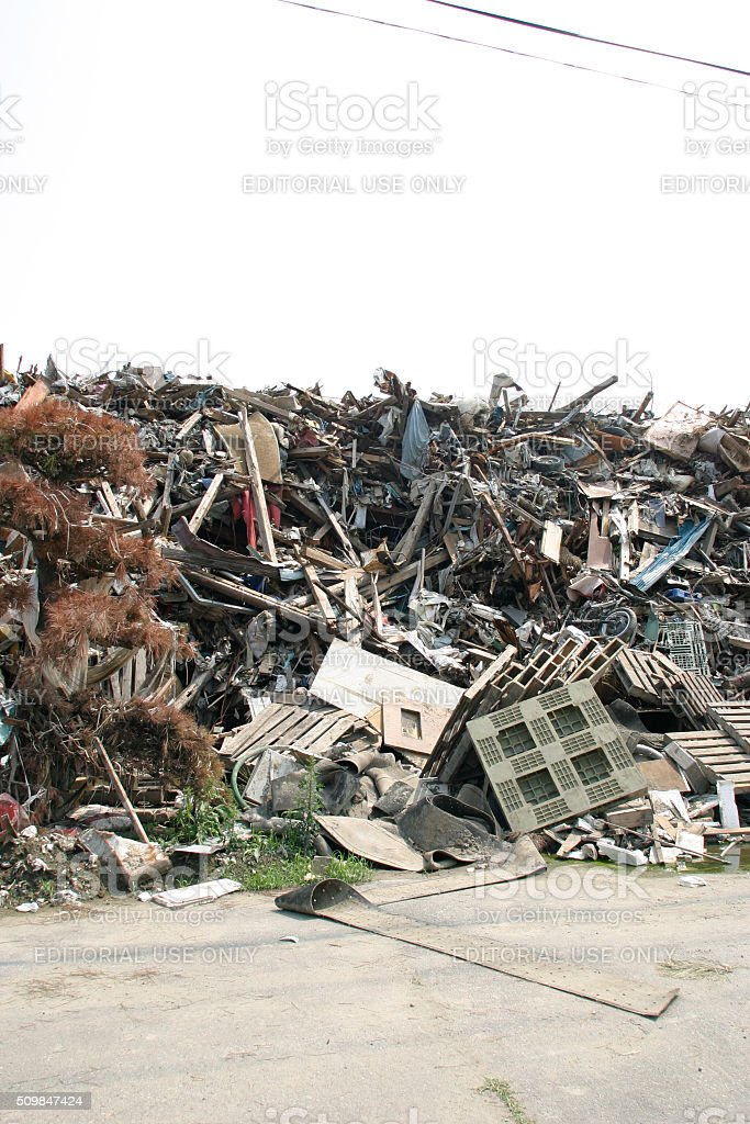 Japan Tsunami Earthquake 2011 Ishinomaki city destruction piles debris stock photo