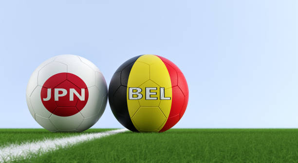 Japan vs. Belgium Soccer Match - Soccer balls in Japan and Belgium national colors on a soccer field. Copy space on the right side - 3D Rendering stock photo
