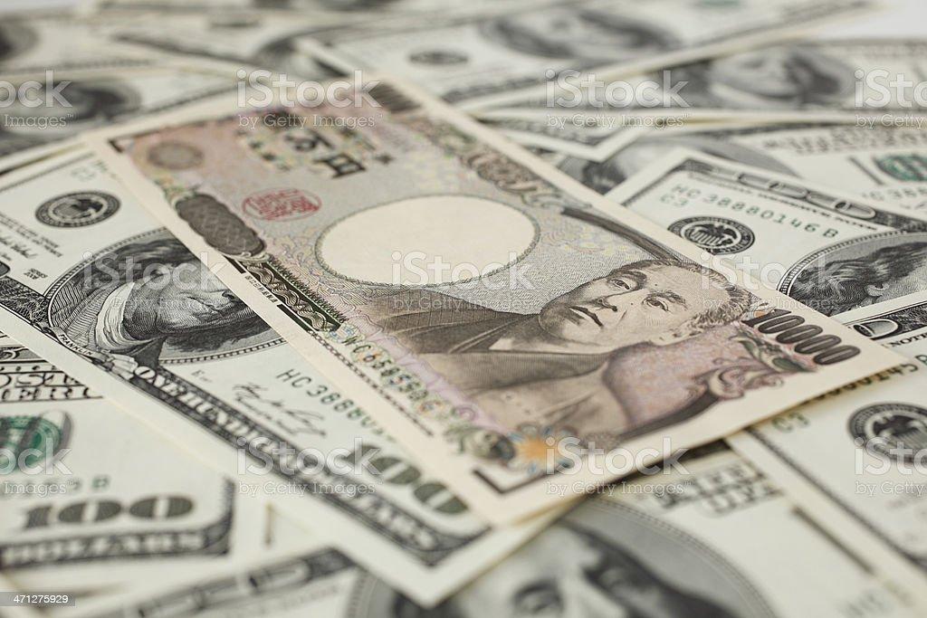 Japanese 10000 yen and 100 Dollar bills stock photo