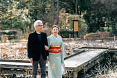 Japanese adult couple walking together.