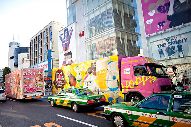 Japanese advertising trucks and billboards stock photo