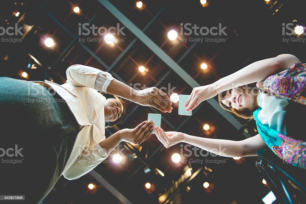 Japanese and African Descent Businesswomen Exchanging Business Cards, Kyoto, Japan stock photo