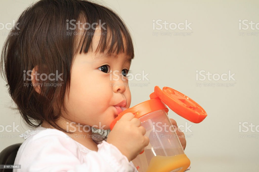 Japanese baby girl drinking water (1 year old) stock photo