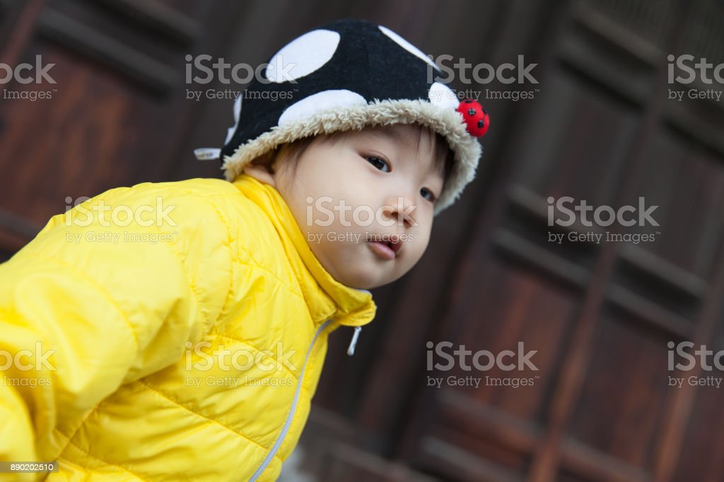 Japanese baby girl in yellow jacket stock photo