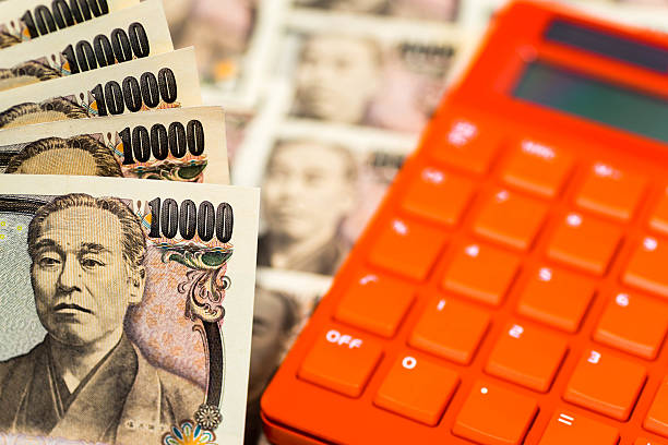 Japanese banknotes with colorful calculator Japanese banknotes with colorful calculator devaluation stock pictures, royalty-free photos & images