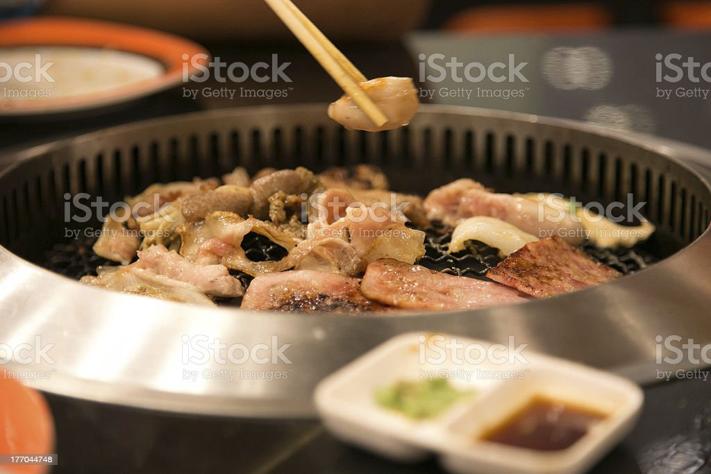 Japanese barbecue in modern stove royalty-free stock photo