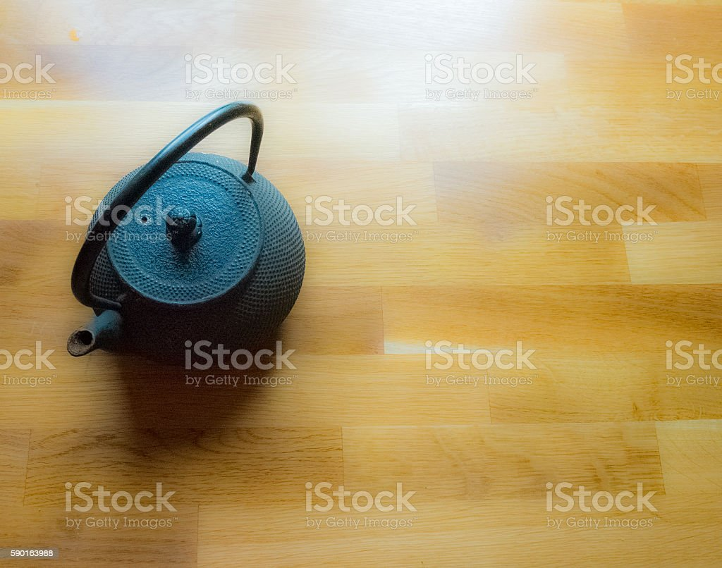 Japanese black teapot on a wooden table stock photo