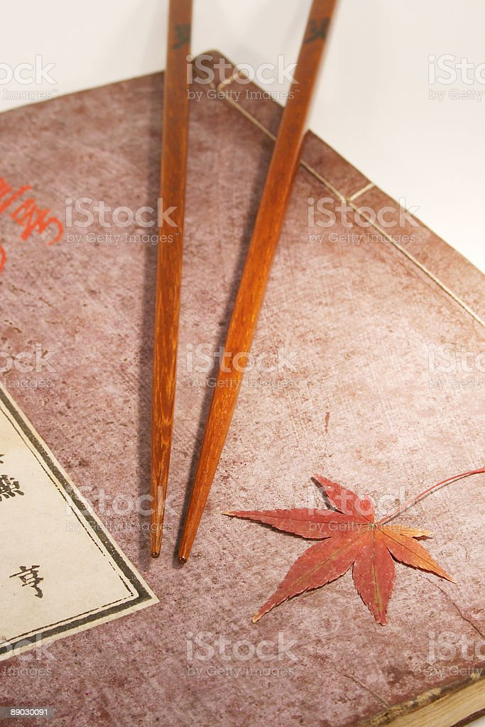 Japanese book Cover with Chopsticks and Maple Leaf stock photo
