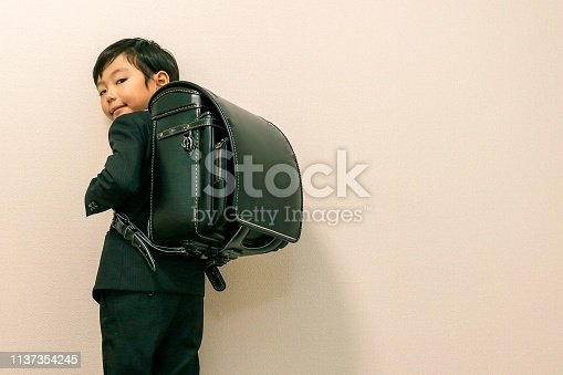 1176772377 istock photo Japanese boy and new school bag 1137354245