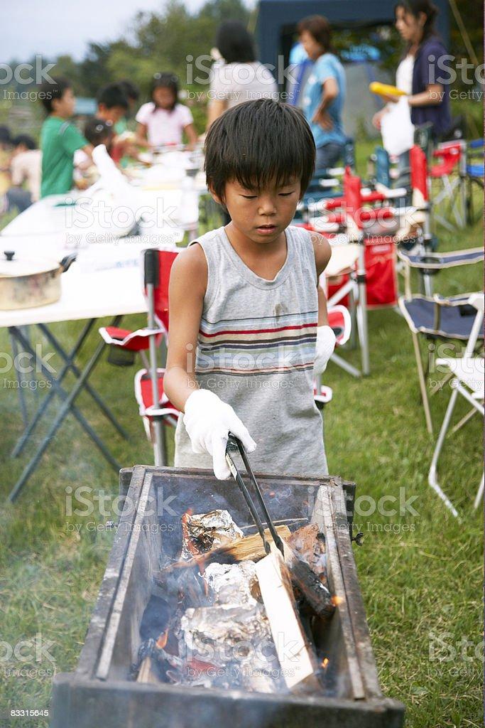 Japanese boy preparing fire royalty free stockfoto