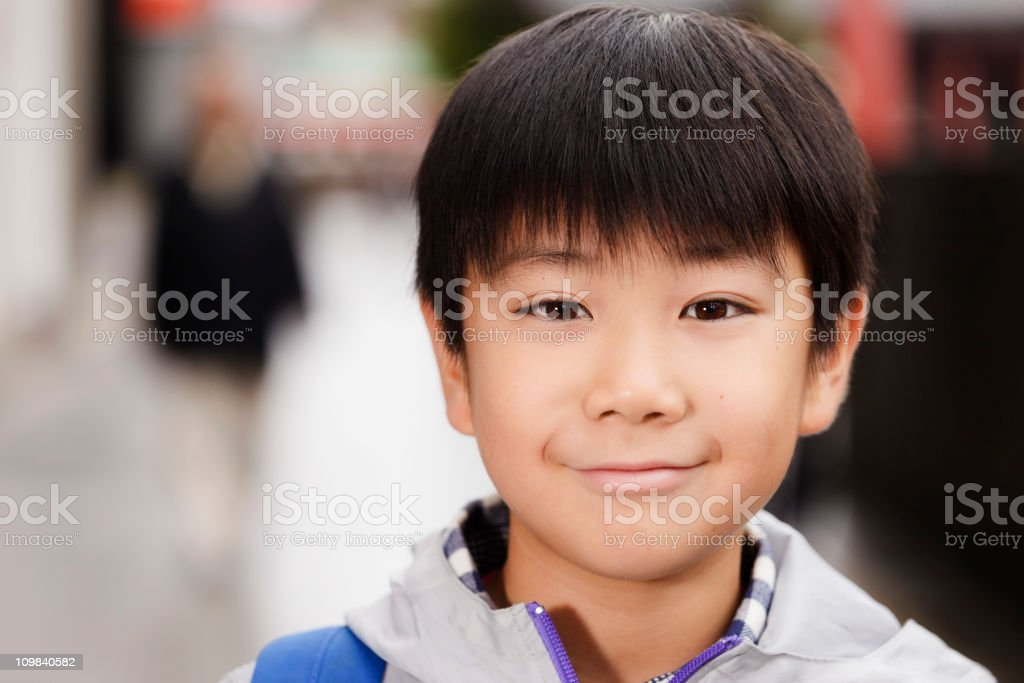 Japanese Boy Standing on a City Street stock photo