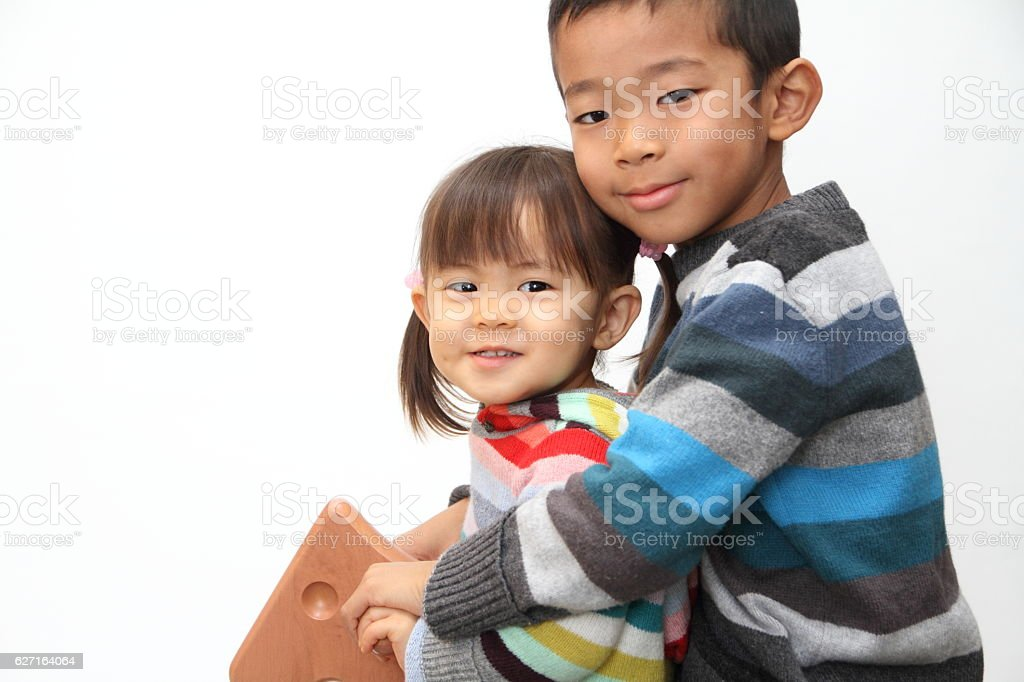 Japanese Brother And Sister Playing With Rocking Horse Stock Photo Download Image Now Istock