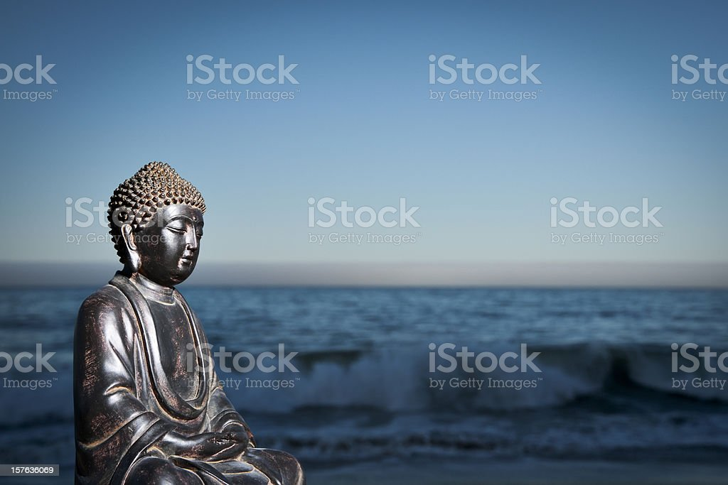 Japanese Buddha Statue at Ocean Shore stock photo