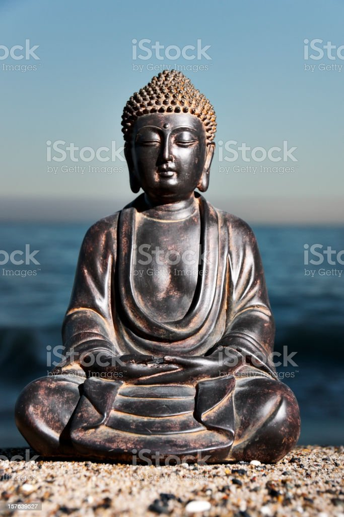 Japanese Buddha Statue at Ocean Shore stock photo