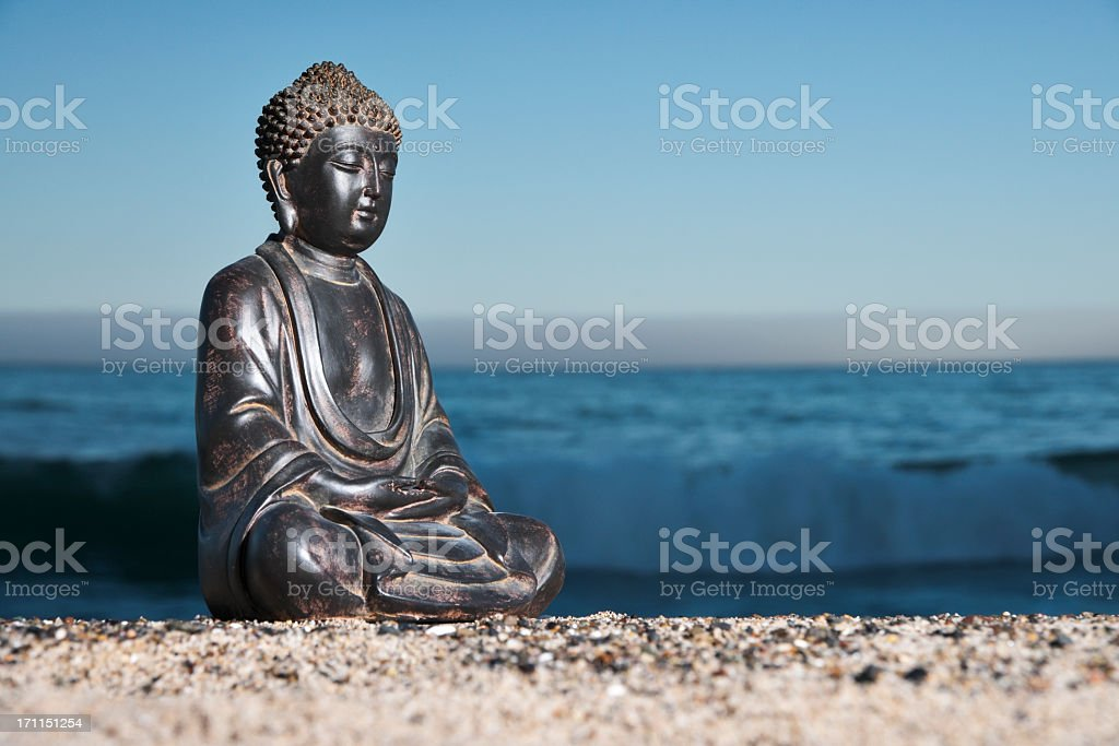 A Japanese Buddha statue on the beach stock photo