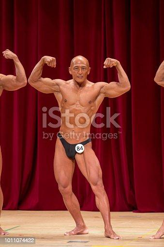 618638418istockphoto Japanese bulky bald head male 50s bodybuider 1011074422