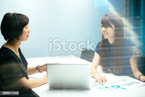 589445574istockphoto Japanese business behind the glass 586947348