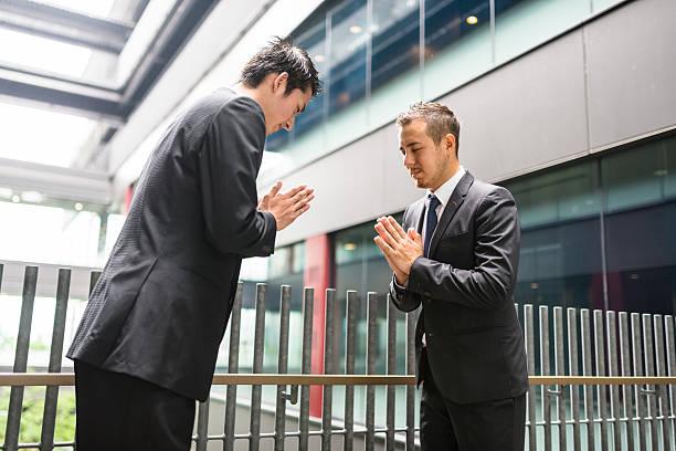 Royalty free japanese business greetings together on the downtown japanese business greetings together on the downtown stock photo m4hsunfo