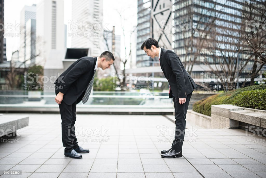 Japanese business greetings together on the downtown stock photo japanese business greetings together on the downtown royalty free stock photo m4hsunfo